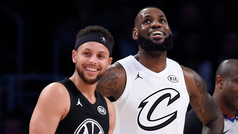 'Team Stephen's' Stephen Curry of the Golden State Warriors and 'Team LeBron's' LeBron James of the Cleveland Cavaliers stand together during the first half of the 2018 NBA All-Star basketball game