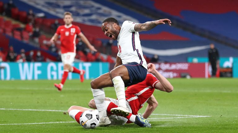 Raheem Sterling is fouled for England's penalty against Poland