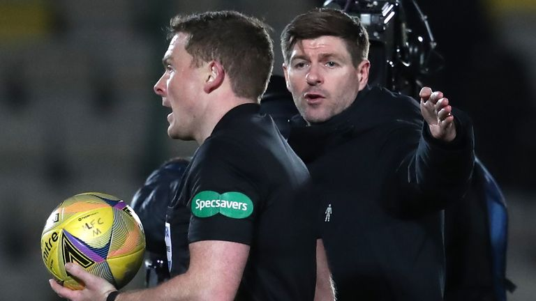 Rangers manger Steven Gerrard speaks to referee John Beaton at half time