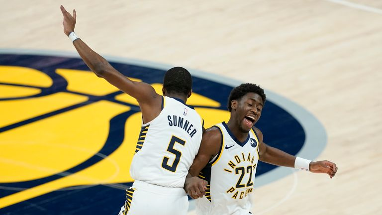 Indiana Pacers' Caris LeVert and Edmond Sumner celebrate during the second half of their game against the Pistons