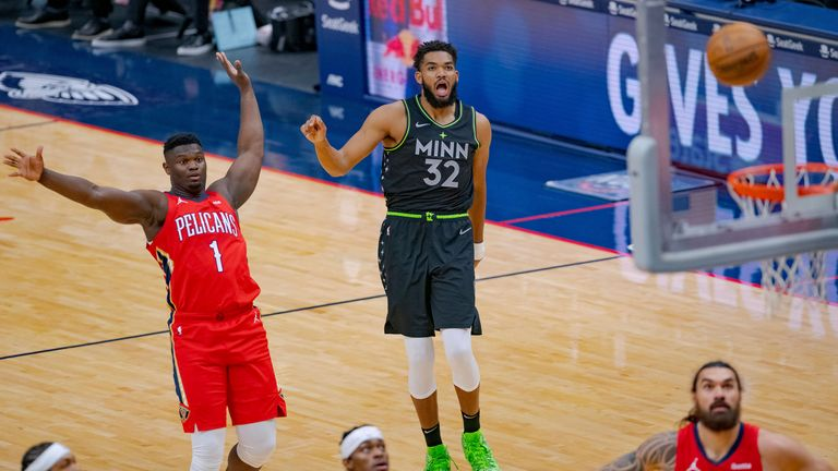Minnesota Timberwolves center Karl-Anthony Towns watches his shot next to New Orleans Pelicans striker Zion Williamson