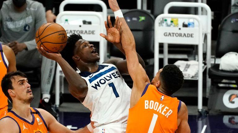Minnesota Timberwolves forward Anthony Edwards drives past Phoenix Suns' Devin Booker