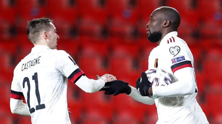 Romelu Lukaku celebrates with Timothy Castagne after scoring the equaliser