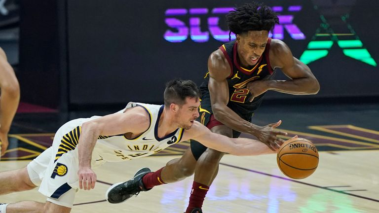 Indiana Pacers' T.J. McConnell and Cleveland Cavaliers' Collin Sexton battle for a loose ball