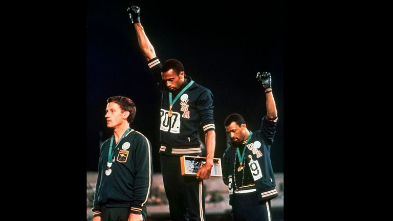 Smith (centre) and Carlos on the podium at the 1968 Olympics with their black-gloved fists in the air is one of sport's most iconic images