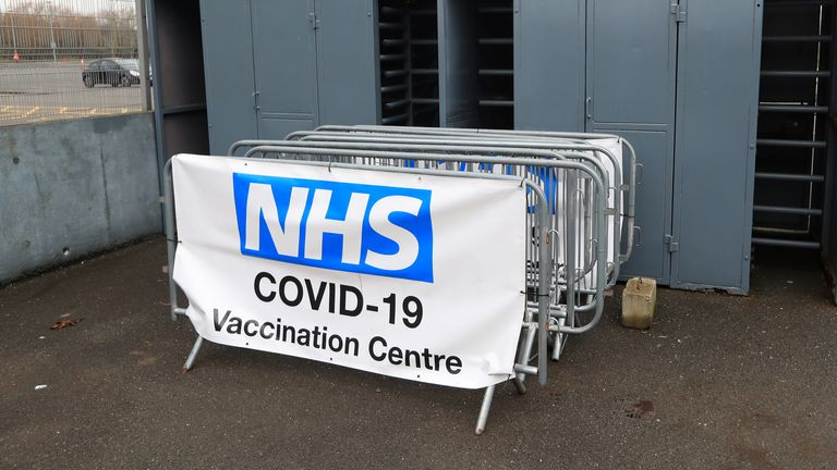 An NHS covid-19 vaccination centre sign at the turnstiles before the Sky Bet League One match at the Pirelli Stadium, Burton.