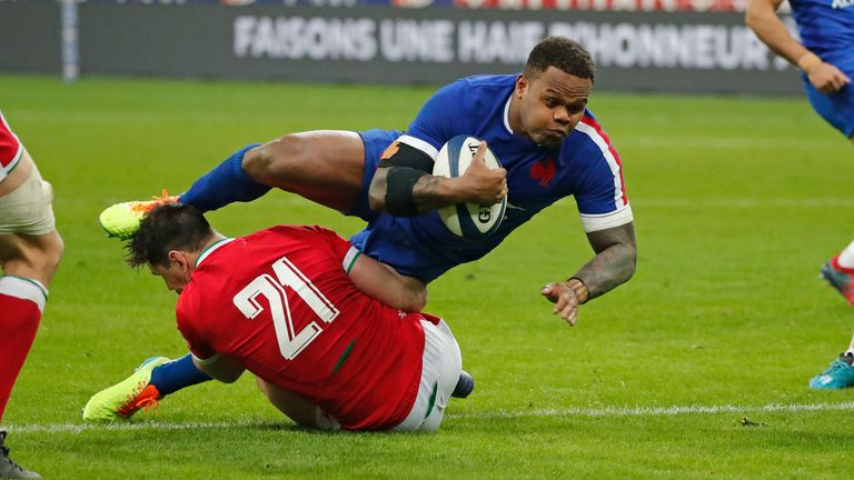 France's Virimi Vakatawa is tackled by Wales replacement Tomos Williams