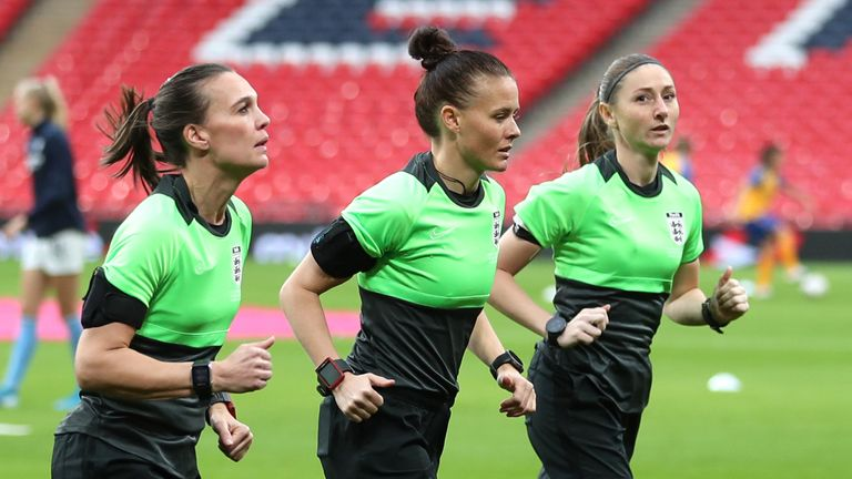 Rebecca Welch, centre, warms up with Sian Massey-Ellis, right, ahead of the Women's FA Cup final at Wembley