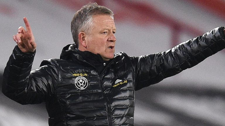 Sheffield United's manager Chris Wilder gives directions to his players during the English Premier League soccer match between Sheffield United and Liverpool at Bramall Lane stadium in Sheffield, England, Sunday, Feb. 28, 2021. (Oli Scarff, Pool via AP)