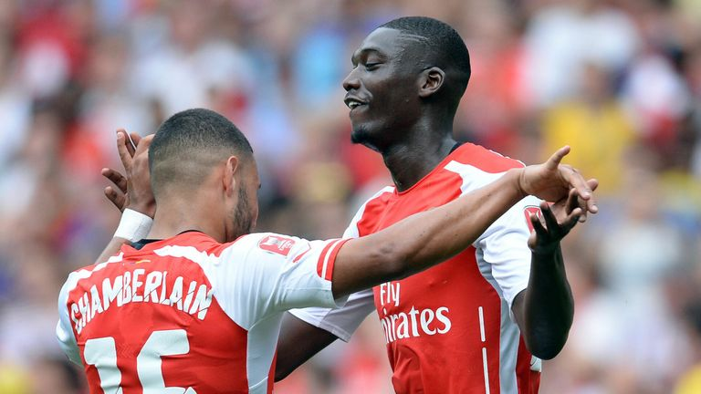 Arsenal's Yaya Sanogo celebrates with team mate Alex Oxlade-Chamberlain (left) after scoring his third and thier side's fourth goal of the game during the Emirates Cup match at The Emirates Stadium, London. PRESS ASSOCIATION Photo. Picture date: Saturday August 2, 2014. See PA story SOCCER Arsenal. Photo credit should read: Andrew Matthews/PA Wire