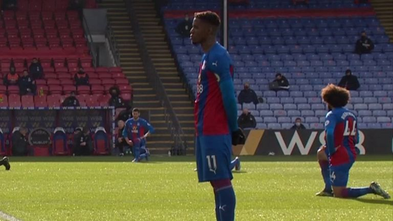 Wilfried Zaha decides to stand instead of taking a knee ahead of Palace's match with West Brom.