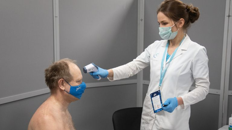 A Zenit fan has his temperature checked at the Krestovsky Stadium's mobile vaccination centre (Credit: FC Zenit)