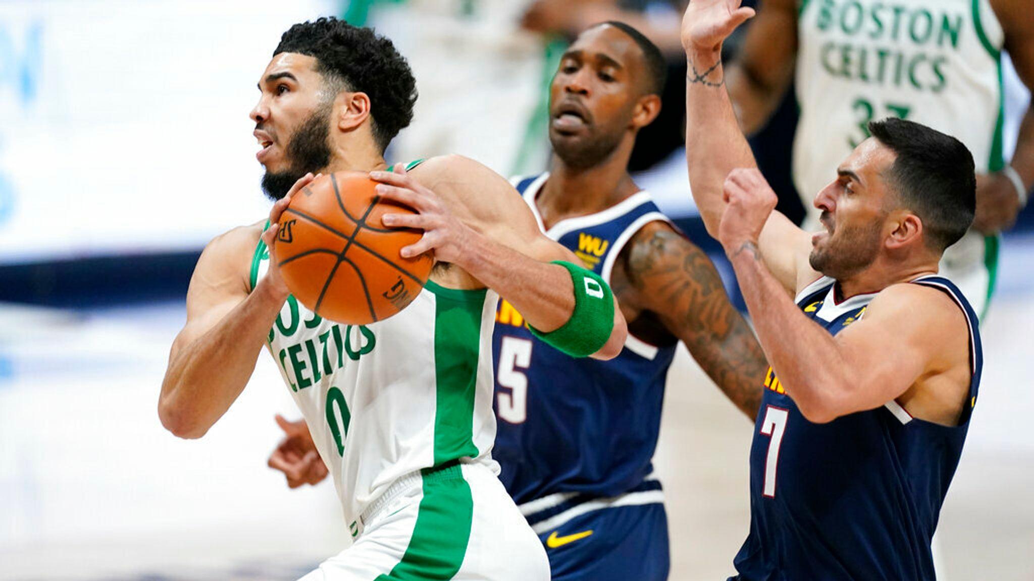 AP - Boston Celtics forward Jayson Tatum, left, drives the lane past Denver Nuggets forward Will Barton,