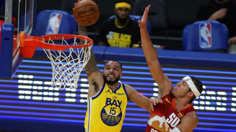 AP - Golden State Warriors' Mychal Mulder, left, shoots against Denver Nuggets' Aaron Gordon