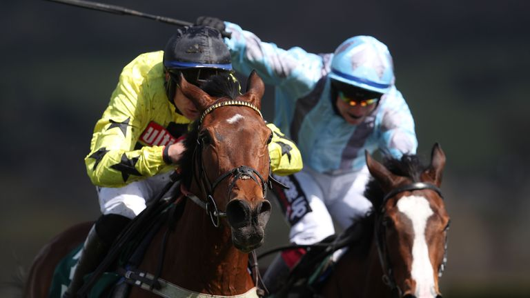 Her Indoors and Adrian Heskin (left) coming home to win at Cheltenham