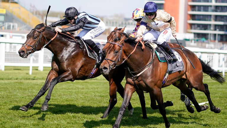 Pat Dobbs riding Chindit (left) win the Watership Down Stud Too Darn Hot Greenham Stakes at Newbury