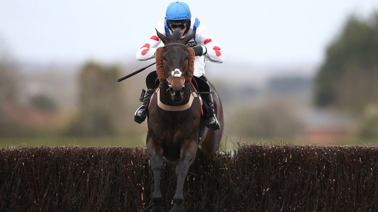 Clan Des Obeaux ridden by Harry Cobden jumps the last at Aintree
