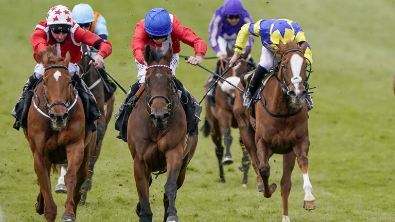 Ryan Moore riding Sacred (centre)