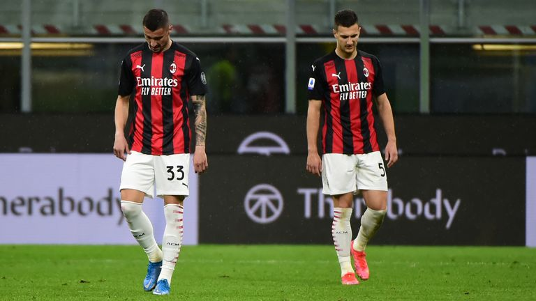 AC Milan's slim Serie A title hopes were dashed by a 2-1 home defeat to Sassuolo