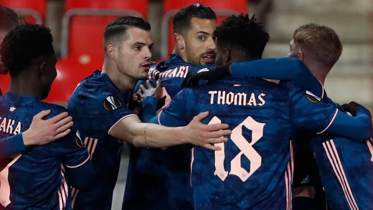 Arsenal's Alexandre Lacazette celebrates with his teammates after scoring his side's second goal from the penalty spot during the Europa League quarter final second leg soccer match between Slavia Prague and Arsenal