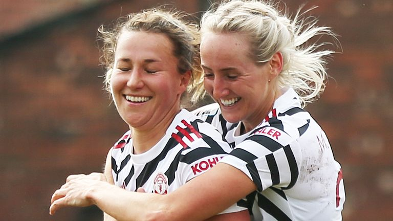 Manchester United's Amy Turner (left) celebrates scoring her side's fourth goal against Aston Villa with Millie Turner