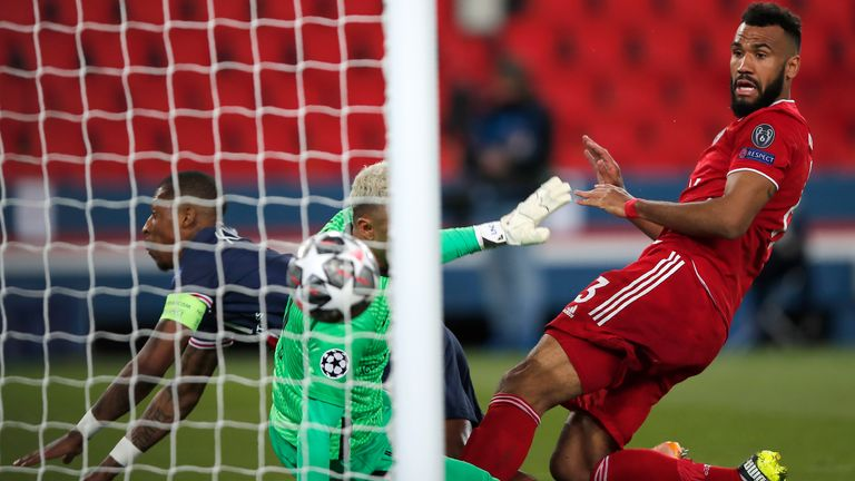 Bayern's Eric Maxim Choupo-Moting, right, scores his side's opening goal during the Champions League, second leg, quarterfinal soccer match between Paris Saint Germain and Bayern Munich at the Parc des Princes stadium, in Paris, France, Tuesday, April 13, 2021. (AP Photo/Francois Mori)