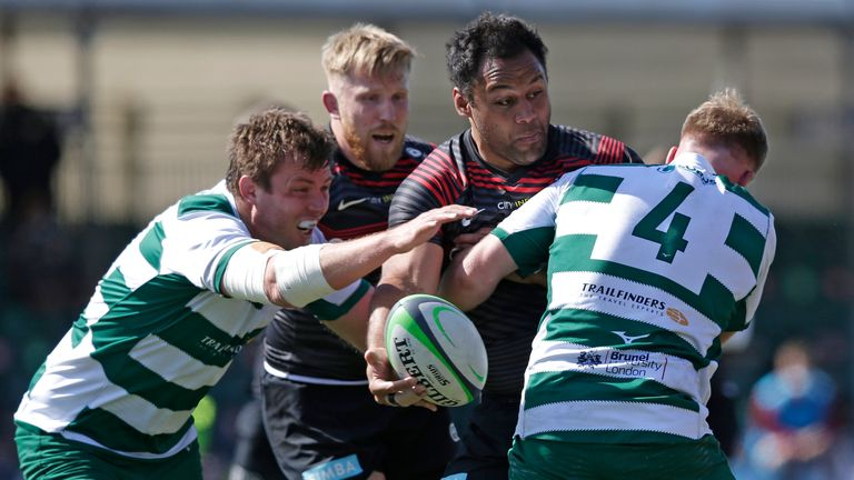 Billy Vunipola of Saracens looks to offload out of a tackle