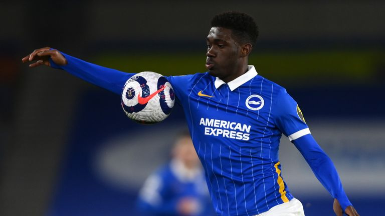 Brighton and Hove Albion's Yves Bissouma commits a handball during the Premier League match at the American Express Community Stadium, Brighton