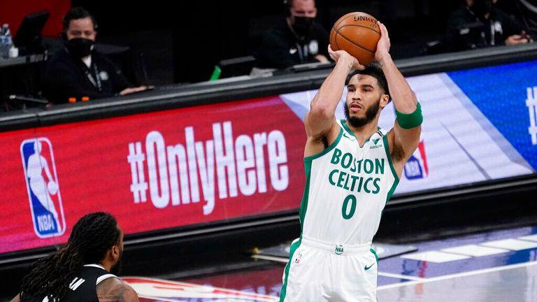 AP - Boston Celtics forward Jayson Tatum (0) shoots a three-point basket past Brooklyn Nets center DeAndre Jordan (6)