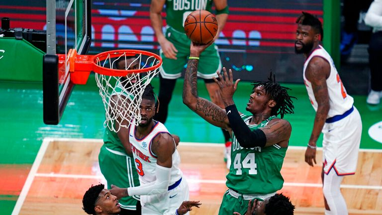AP - Boston Celtics center Robert Williams III (44) shoots against the New York Knicks