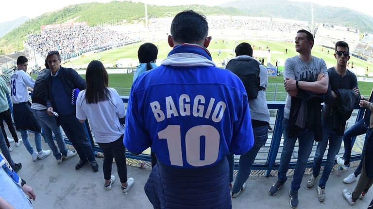 A fan of Brescia Calcio wearing a shirt of Roberto Baggio celebrates the victory of the Serie B championship after the Serie B match between Brescia Calcio and Ascoli Calcio 1898 FC at Stadio Mario Rigamonti on May 1, 2019 in Brescia, Italy.
