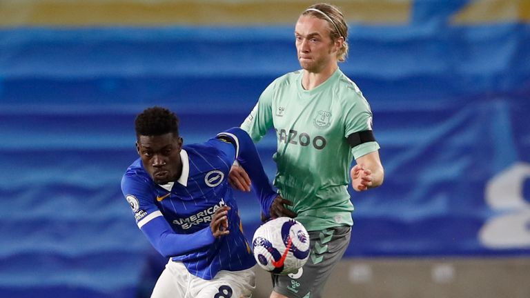 Brighton's Yves Bissouma, left, is challenged by Everton's Tom Davies during the English Premier League soccer match between Brighton and Everton at the Falmer Stadium in Brighton, England, Monday, April 12, 2021. (Paul Childs/Pool via AP)
