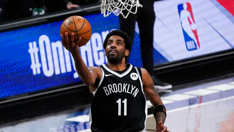 AP - Brooklyn Nets guard Kyrie Irving goes to the basket during the second half of an NBA basketball game against the Boston Celtics