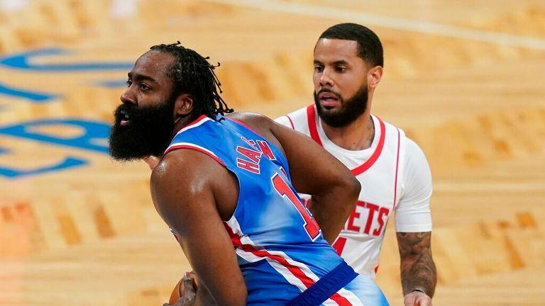 NBA - Brooklyn Nets' James Harden, right, drives past Houston Rockets' D.J. Augustin