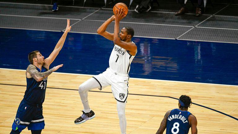 AP - Brooklyn Nets forward Kevin Durant (7) shoots over Minnesota Timberwolves forward Juancho Hernangomez (41)