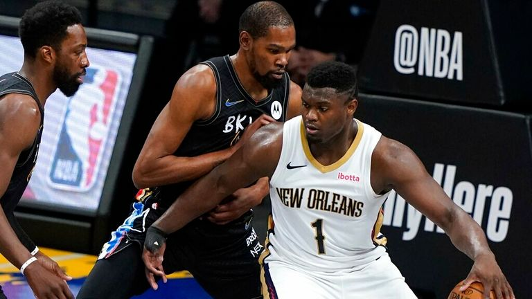 AP - Brooklyn Nets' Kevin Durant (7) defends New Orleans Pelicans' Zion Williamson (1)