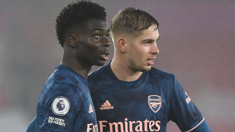 Bukayo Saka and Emile Smith Rowe of Arsenal during the Premier League match between Southampton and Arsenal at St Mary's Stadium on January 26, 2021 in Southampton, England.