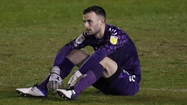Cambridge keeper Callum Burton shows his dejection at full time