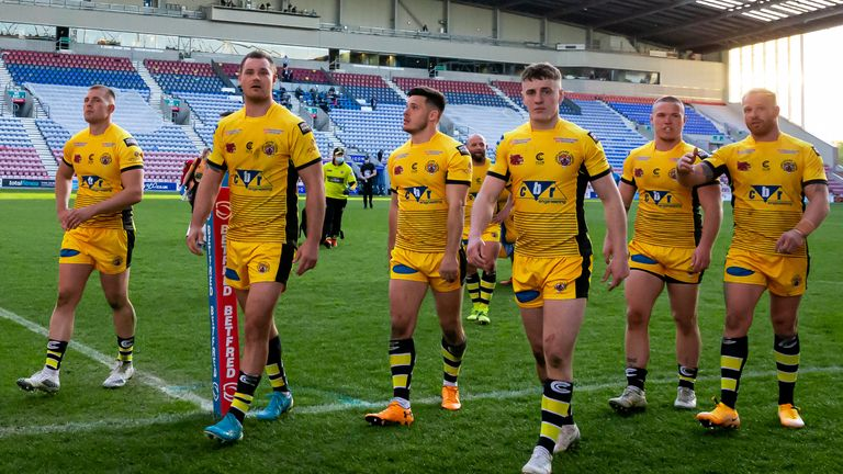 Castleford players look dejected following the defeat