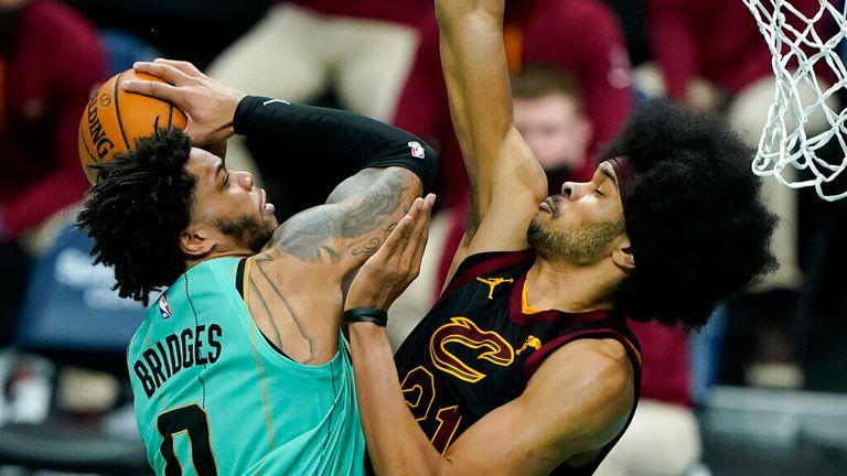 AP - Charlotte Hornets forward Miles Bridges shoots past Cleveland Cavaliers center Jarrett Allen