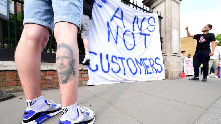 PA - Chelsea supporters display a 'fans not customers' banner in protest over plans for a European Super League