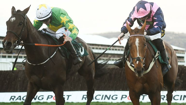Cheltenham , United Kingdom - 12 March 2019; Le Breuil, with Jamie Codd up, right, races ahead of Discorama, with Barry O'Neill up, on their way to winning the National Hunt Challenge Cup Amateur Riders' Novices' Chase on Day One of the Cheltenham Racing Festival at Prestbury Park in Cheltenham, England. (Photo By David Fitzgerald/Sportsfile via Getty Images)