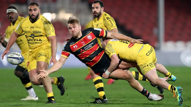 Chris Harris offloads the ball as he is tackled against La Rochelle