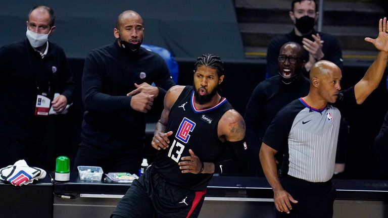 Los Angeles Clippers guard Paul George reacts after making a 3-point basket
