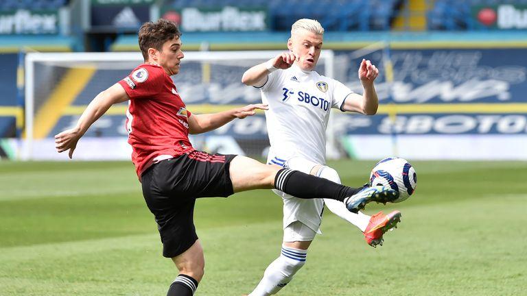 Daniel James challenges Leeds United's Ezgjan Alioski (AP)