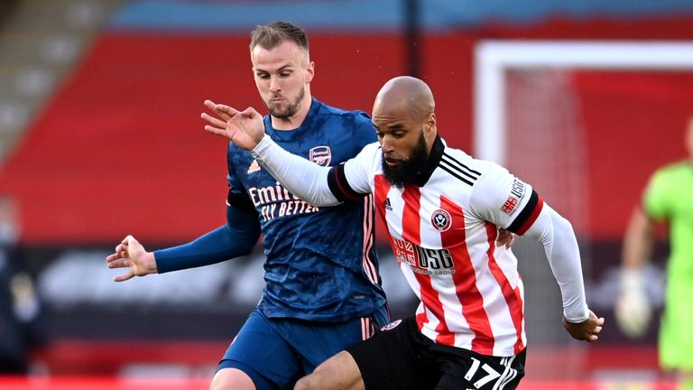David McGoldrick holds the ball up with Rob Holding for company