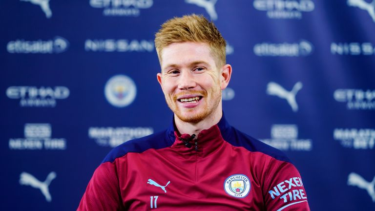 GETTY - Kevin de Bruyne is all smiles following the signing of his extended Manchester City deal