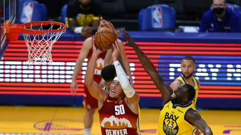 AP - Denver Nuggets' Aaron Gordon, left, shoots against Golden State Warriors' Draymond Green
