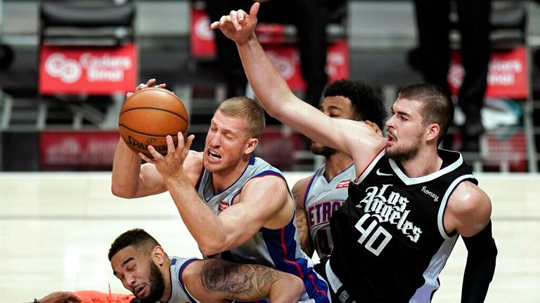 AP - Detroit Pistons' Mason Plumlee, center, lands on teammate Cory Joseph as he grabs a rebound against Los Angeles Clippers' Ivica Zubac,
