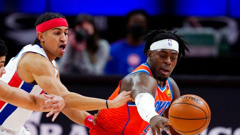AP - Detroit Pistons guards Killian Hayes, left, Frank Jackson and Oklahoma City Thunder forward Luguentz Dort, right, reach for the loose ball